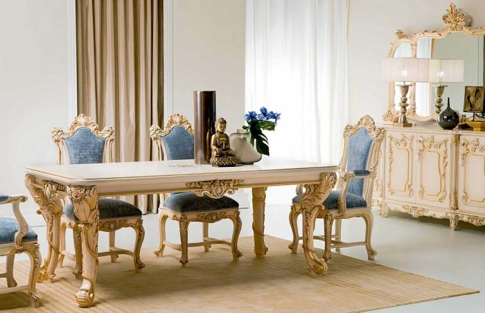 Замечательная столовая со статуей Будды посреди обеденного стола.