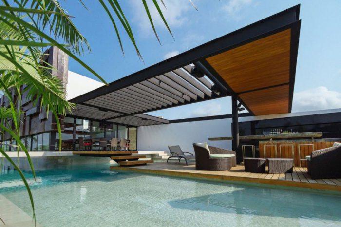 Дом с крышей над бассейном.