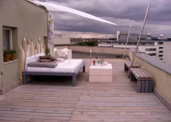 Кровать, с которой открывается необыкновенно красивый вид на весь город.