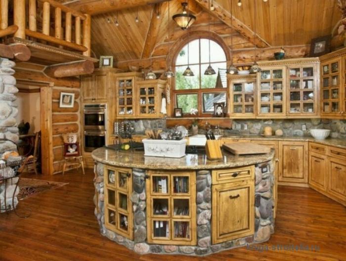 Тумба для хранения кухонных принадлежностей в виде небольшого островка посреди кухни.
