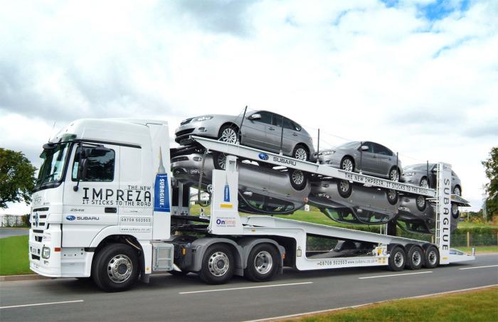 Транспортировка автомобилей заказчикам.
