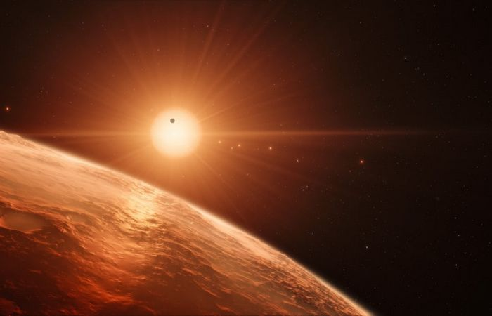 Зарисовка системы звезды TRAPPIST-1.