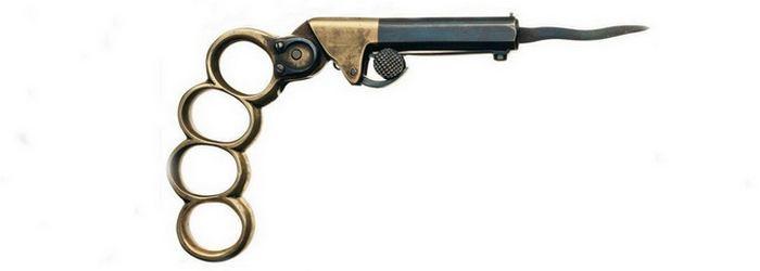 Капсюльный пистолет - кастет - кинжал.