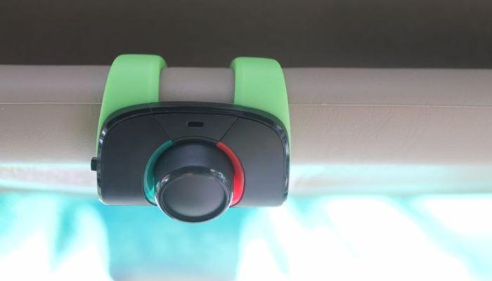 Автомобильная гарнитура-транслятор MINIKIT Neo.