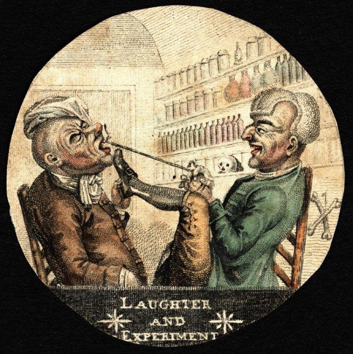 Дантист вырывает зуб у пациента.