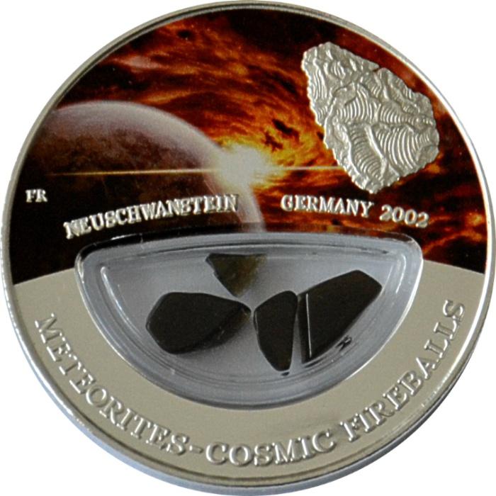Серебряная монета с фрагментами метеорита