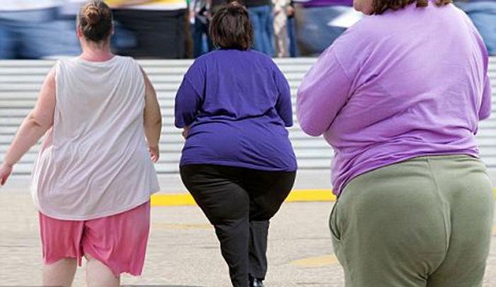 Женщины, страдающие ожирением.