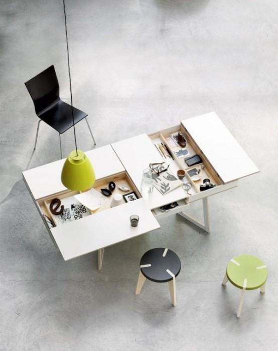 Функциональный раздвижной стол, позволяющий работать и хранить 1000 и одну мелочь в одном месте.