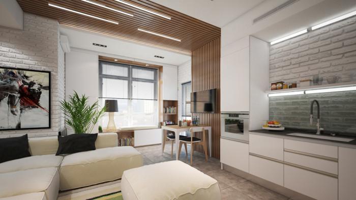 Гостиная, кухня и обеденная зона размещаются на площади в 25 квадратных метров.