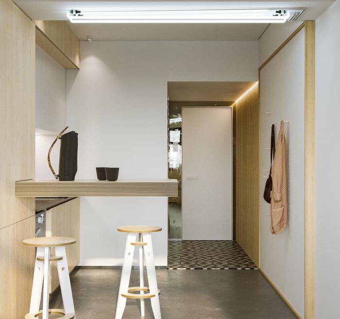 Для экономии пространства в малогабаритной квартире дизайнер сделал выдвижной обеденной стол.