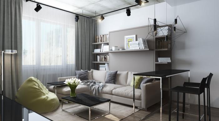 Гостиная со светло-серым диваном, который стоит прямо у окна.
