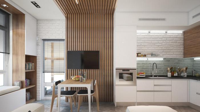 Белый кухонный гарнитур прекрасно гармонирует с деревянными элементами в декоре.
