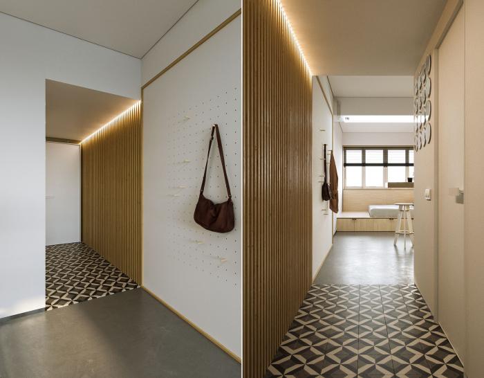 Прихожая-коридор в квартире, оформленной в стиле минимализма.