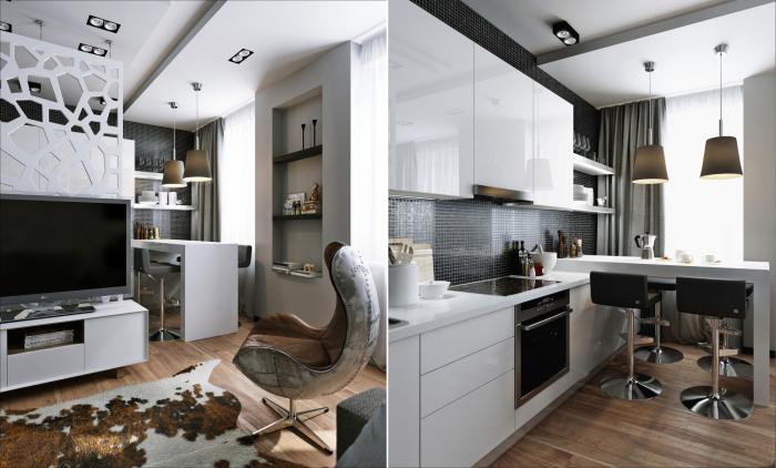 Узкая белая перегородка делит пространство комнаты на две зоны: гостиную-спальню и кухню.