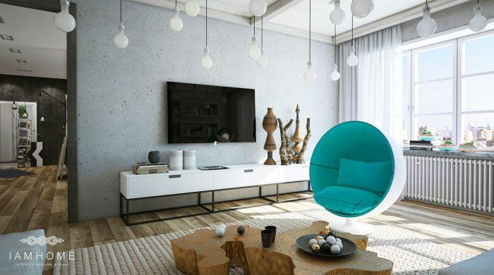 Яркие акценты этой просторной гостиной - забавное кресло-яйцо и золотистый журнальный столик необычной формы.