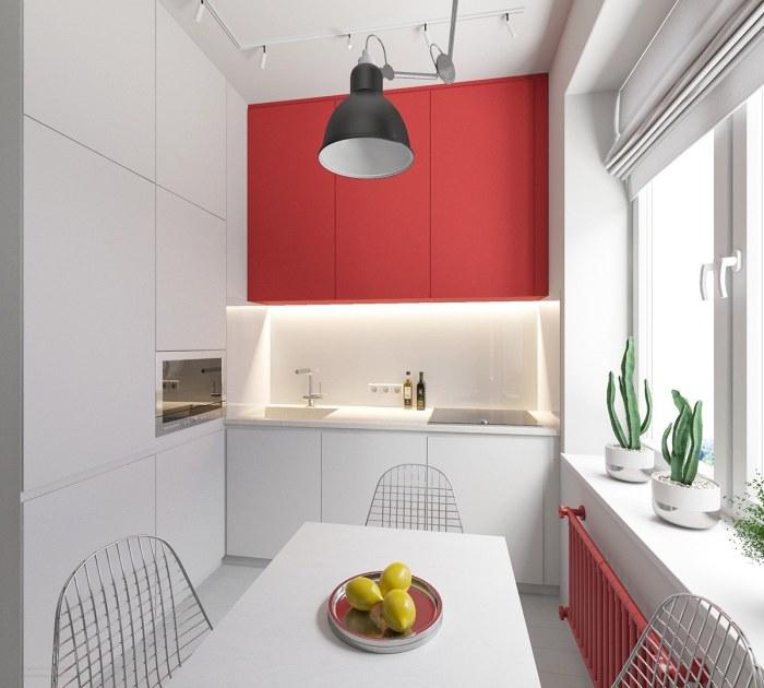 Кухня с красно-белым гарнитуром и красными батареями.