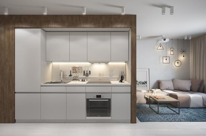 Белый кухонный гарнитур, встроенный в деревянную нишу.