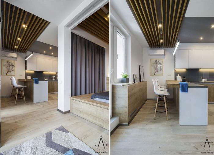 Открытое пространство, в котором разделены гостиная, кухня и ниша, отделяющая спальную зону.