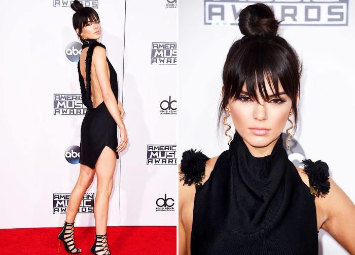 Кендалл Дженнер (Kendall Jenner) в мини-платье черного цвета от дизайнера Oriett Domenech. Американская модель дополнила образ оригинальной прической и массивными аксессуарами.