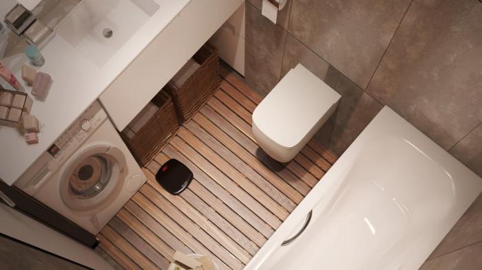 Вместительный санузел, в котором располагается ванная, унитаз, раковина, стиральная машина и стеклянный стеллаж для различных туалетных принадлежностей.
