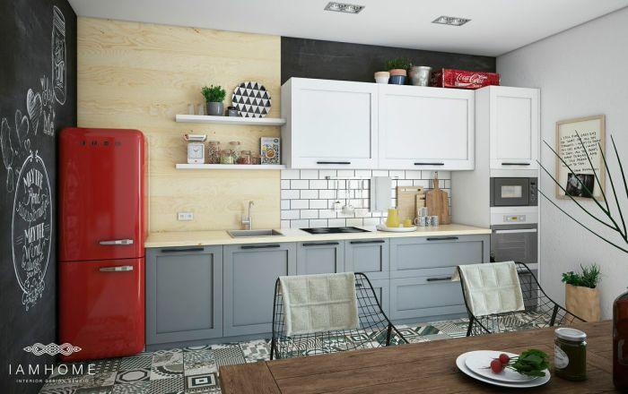Кухня с ярко-красным холодильником и доской для рисования.