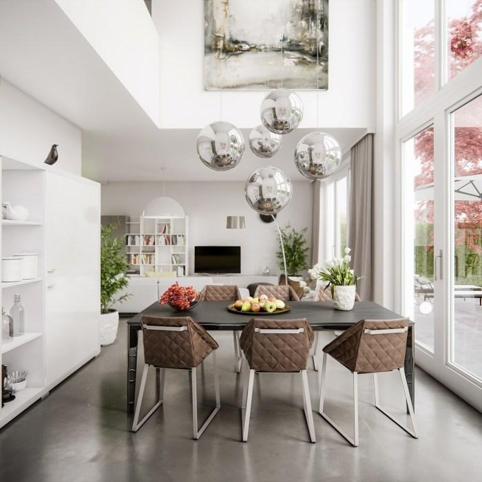 Стильный подвесной потолочный светильник в виде хромированных сфер над обеденной зоной.