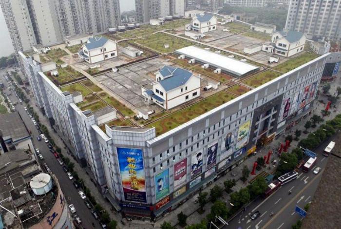 Двухэтажные вилы на крыше в Китае.