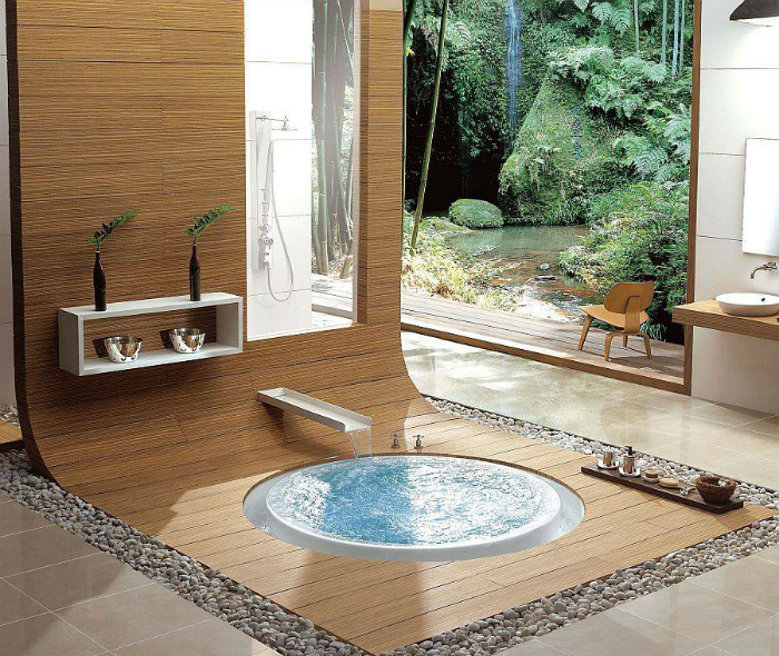 Небольшая круглая ванна, вмонтированная в пол.