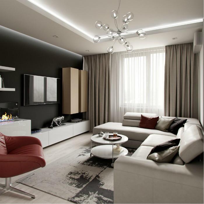 Светлая гостиная с черной стеной.