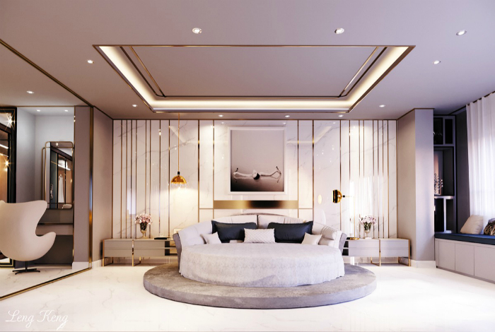 Белая спальня с круглой кроватью.