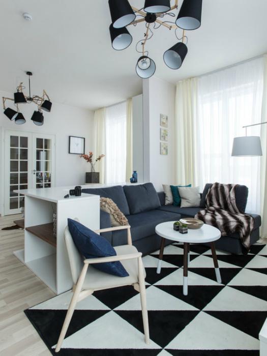 Стильное оформление гостиной в небольшой квартире-студии.