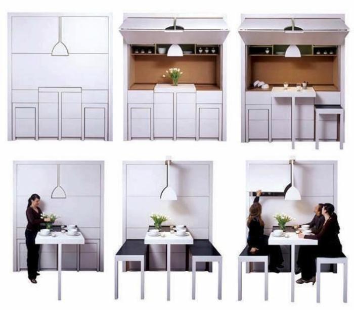 Удивительный кухонный гарнитур с большим выдвижным столом и скамейками.