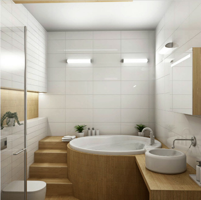 Небольшая ванна с элементами из светлого дерева.