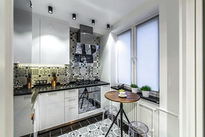 Лаконичная черно-белая кухня.