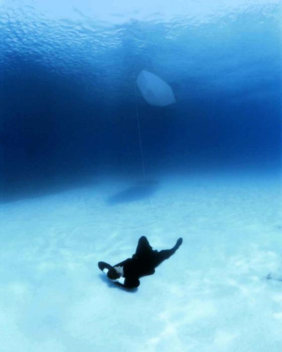 Под водой.