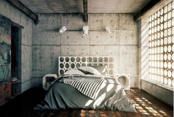 Спальня с бетонными стенами.