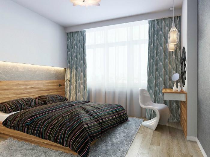 Маленькая спальня с рабочей зоной.