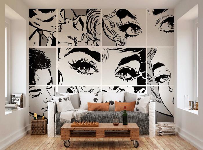 Черно белые фрагменты комиксов на стене.