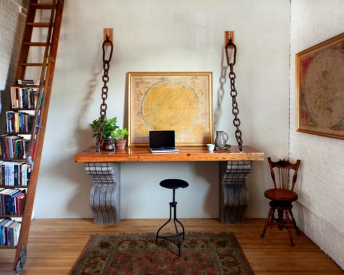 Рабочая зона с оригинальным подвесным столом.