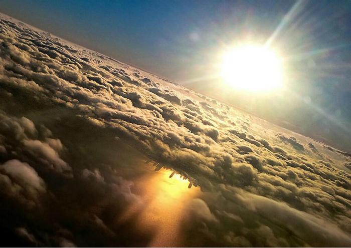 Отражение Чикаго в озере Мичиган. Фотограф: Марк Херш.