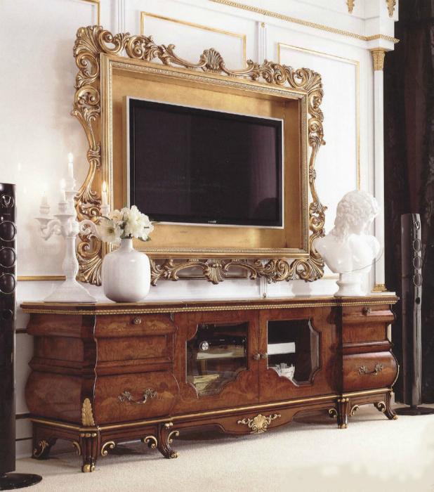 Плазменный телевизор, висящий на стене можно оформить рамой, багетом или широким молдингом.