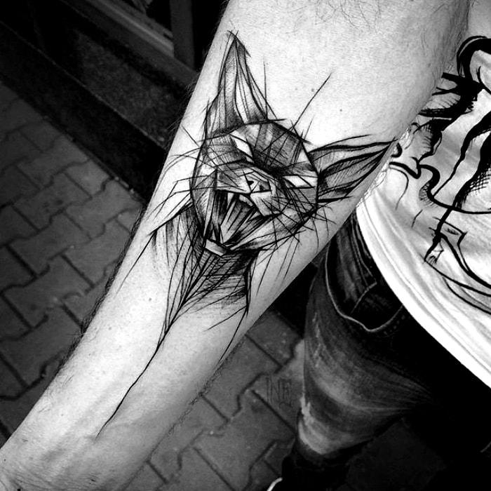 Татуировка с изображением кота.