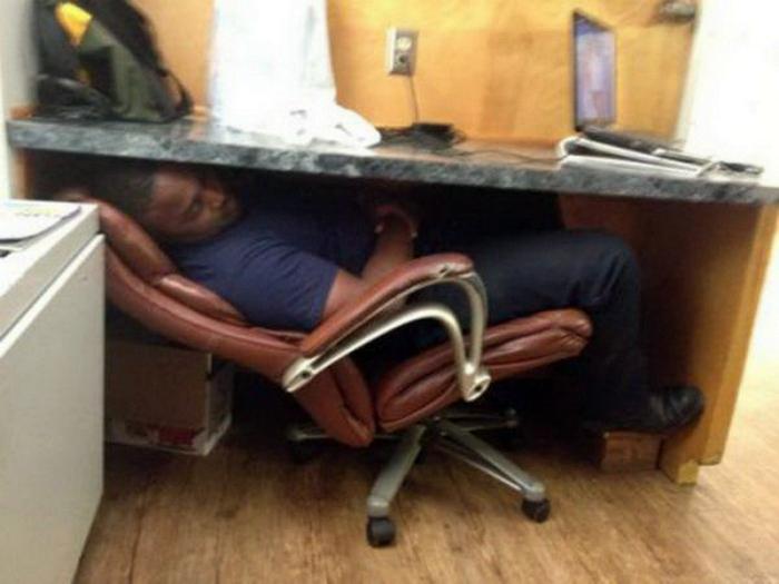 Под столом.