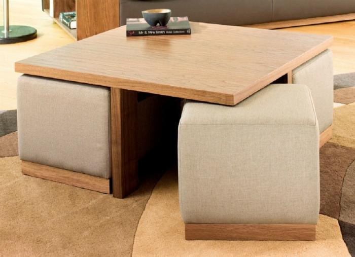 Кофейный столик и четыре пуфика.
