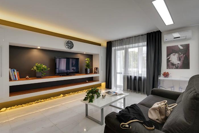 Современный дизайн гостиной с элементами минимализма.