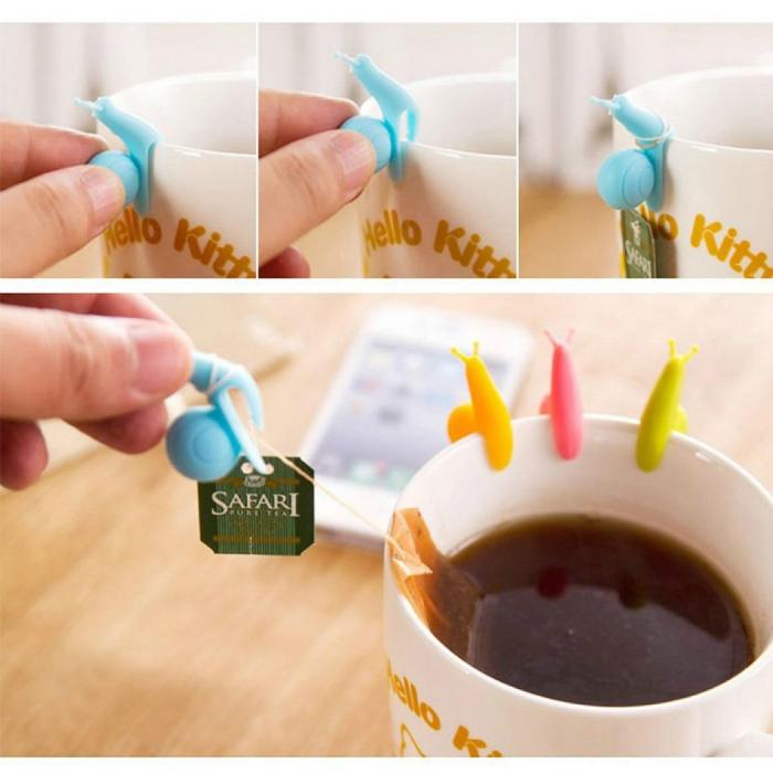Яркие силиконовые улитки для поддержки чайных пакетиков на чашке.
