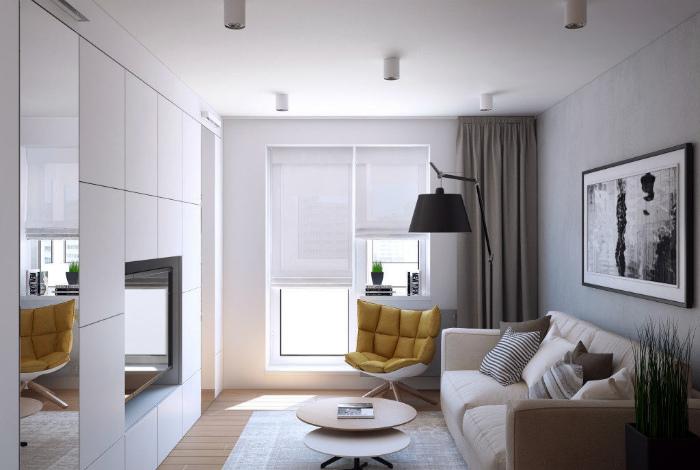 Лаконичный интерьер однокомнатной квартиры в светлых тонах.