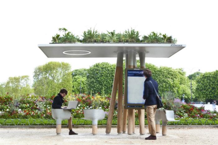 Футуристическая Wi-fi станция с комфортабельными стульями для отдыха, которая сверху выглядит, как клумба.