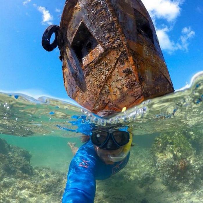 Из-под воды.