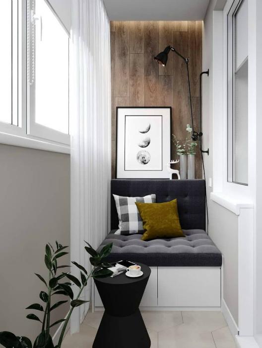 Диванчик и акцентная стена, украшенная деревянными панелями. | Фото: Pinterest.